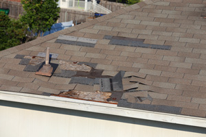 Roof with damaged shingles in need of repair